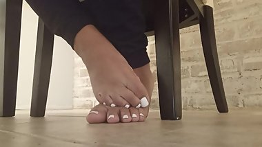 White toes at dinner table