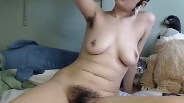 Lovely emo beauty flaunts her hairy pussy in your face