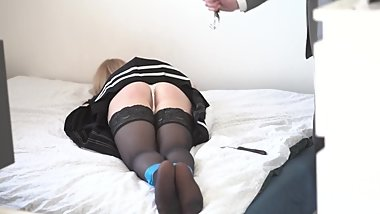Handcuffed schoolgirl spanked with a belt
