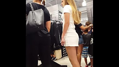 Candid voyeur hot blonde in tight short dress shopping mall