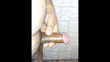 Alone Indian boy playing and oiling his dick
