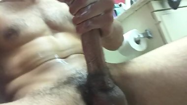 post-gym hunk strokes cock, shows off butt, and nuts on stomach!!