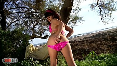 Nice teen Lucia Nieto doing a strip on the beach