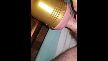 Young guy enjoying his new fleshlight
