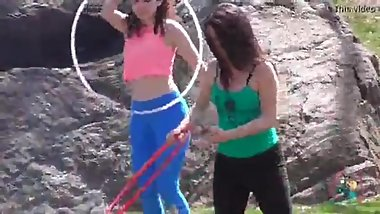 Candid two teens in leggings with hula hoops (part 1)