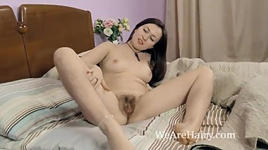 Vita awakens in bed to oil down her hairy body